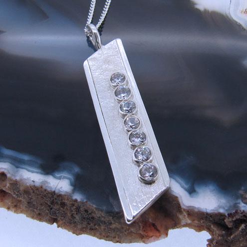Gemstone and silver geometric jewellery design